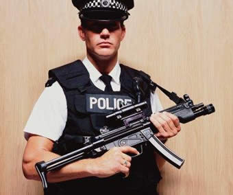 17PoliceOfficerHoldingMachineGun