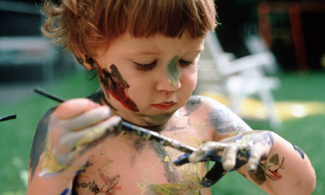 child painting himself